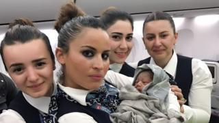 Turkish Airlines stewards with baby Kadiju