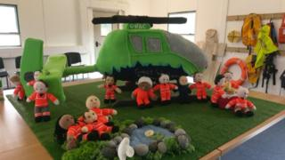 Knitted air ambulance and crew