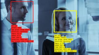 Technology Concept graphic showing a man and a woman detected by facial recognition software