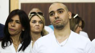 Former Israeli soldier Elor Azaria, who was convicted of manslaughter and sentenced to 18 months imprisonment for killing a wounded and incapacitated Palestinian assailant, waits to hear the ruling at an Israeli military appeals court in Tel Aviv, 27 September 2017