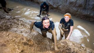 Participants emerging from the mud
