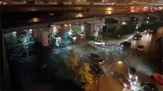 Cars driving on flooded streets