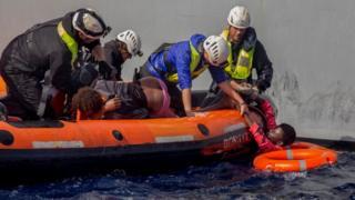 Migrants are rescued by members of German charity Sea-Watch in the Mediterranean Sea on November 6, 2017