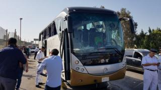 Police near the shattered bus in Giza, Egypt, 19 May