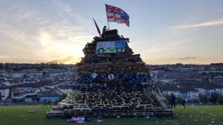 Flags were places on the bonfire near the city walls on Tuesday night
