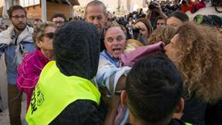 Yizhar Hess, head of the Conservative Movement in Israel ,holds a Torah scroll during scuffles by the Western Wall, in Jerusalem's Old City on 2 November 2016