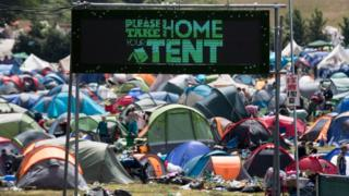 """Please take home your tent"" sign at Glastonbury"