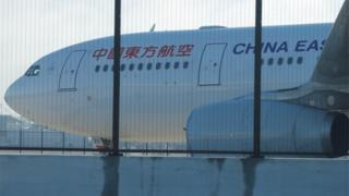 A China Eastern Airlines Airbus A330 aircraft sits on the tarmac at Sydney International Airport in Australia