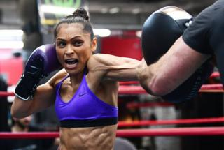 Louisa Hawton, of Australia, works out with her trainer at Gleason's Gym in New York. Hawton will take on Los Angeles native Lorraine Villalobos in a rematch for the Women's Interim WBC Straw-weight Championship on 7th December.