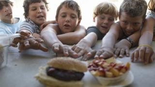 sports Children reaching for fast food