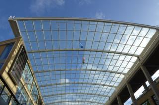 A window cleaner on the roof of the Westgate Shopping Centre