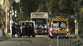 Nice terror attack: French police forces and forensic officers stand next to a truck July 15, 2016 that ran into a crowd celebrating the Bastille Day national holiday on the Promenade des Anglais