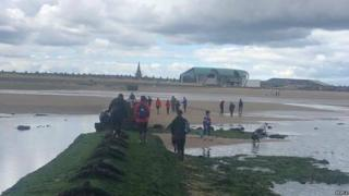 People walking towards the beach in Redcar