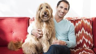 Aaron Hirschhorn and his golden labradoodle Rocky