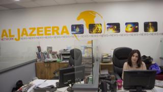 Employees of Al Jazeera satellite channel work at their Jerusalem bureau, Israel, 14 June 2017