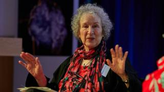 Author Margaret Atwood gesturing as she speaks