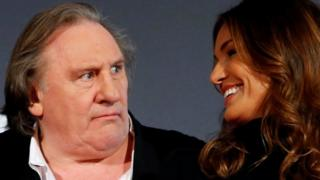 Actor Gerard Depardieu and actress Nadia Fares pose on the red carpet at the French premiere of Netflix's TV series Marseille