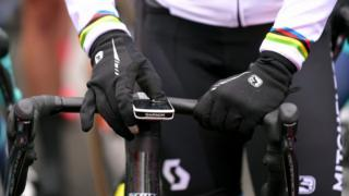 A Garmin device is seen mounted to the handlebar of an expesnive racing bike