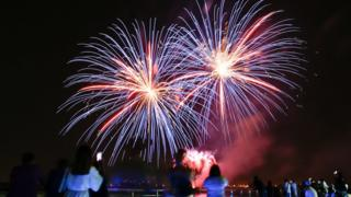 Fireworks illuminate the sky over the Yas Marina on the third day of the Muslim holiday of Eid Al-Fitr at the Marina on Yas Island, Abu Dhabi, United Arab Emirates,