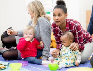 Parents and babies at a healthy eating class in London