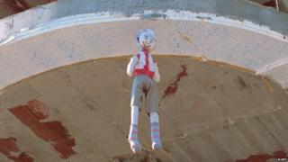 Dummy hanging from building in Albania