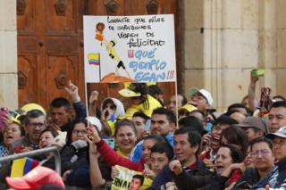 "Fans hold a sign that reads ""You made millions of hearts shake with happiness. What an example, Egan!"" during a tribute to Colombian cyclist Egan Bernal, winner of the Tour de France 2019, at his hometown, Zipaquira, in Cundinamarca, Colombia"