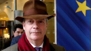 Nigel Farage leaves a meeting at the EU Commission headquarters in Brussels