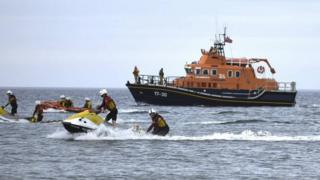 RNLI lifeboats and a Coastguard helicopter were lauched at at about 18:40 BST on Saturday