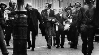 A victim of Bloody Sunday is carried through the streets of Derry