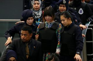 "Vietnamese Doan Thi Huong, who is on trial for the killing of Kim Jong Nam, the estranged half-brother of North Korea""s leader, is escorted as she revisits the Kuala Lumpur International Airport 2 in Sepang, Malaysia 24 October 2017."
