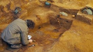 An archaeologist excavating at Prittlewell