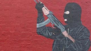 Paramilitary figure in mural