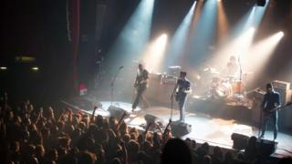 US band Eagles of Death Metal performing on stage on November 13, 2015