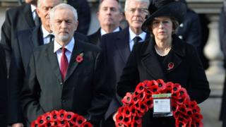 Theresa May and Jeremy Corbyn holding wreaths