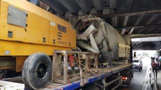 Lorry wedged under bridge