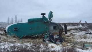 Crashed helicopter lying on a field