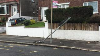 Damage caused by a collision on the Ballysillan Road in north Belfast