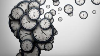 Forma de cabeza humana hecha con relojes