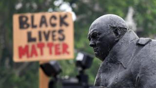 Statue of Churchill in Parliament Square with Black Lives Matter sign