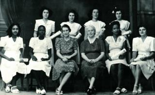 Girls sitting for a school photograph