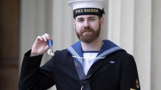 Leading Seaman David Groves with his Queens Gallantry Medal