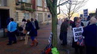 Campaigners outside the budget meeting in Preston