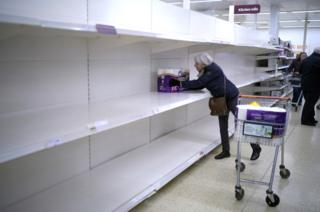 in_pictures A senior citizen gets the last pack of toilet rolls at Sainsbury's Supermarket in Northwich, United Kingdom