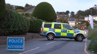 Police car shutting off road