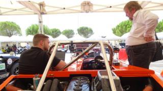 Tim Coleman (right) surveys a car