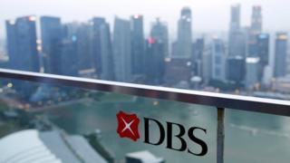 DBS logo and Singapore skyline