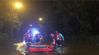 Firefighters in the flood water in Walsall