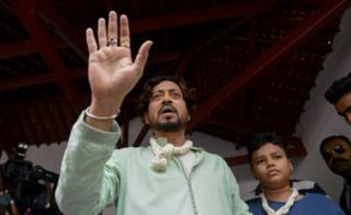 Indian actor Irrfan Khan speaks to the media next to his son Aayan at the Mahatma Gandhi Ashram in Ahmedabad on June 19, 2016, on Father's Day.