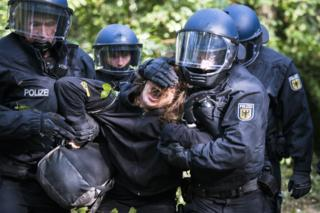 Police removing a protester in September 2018