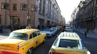 New York taxis and US cars on the streets of Glasgow